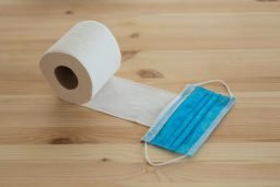 white toilet paper roll on brown wooden table